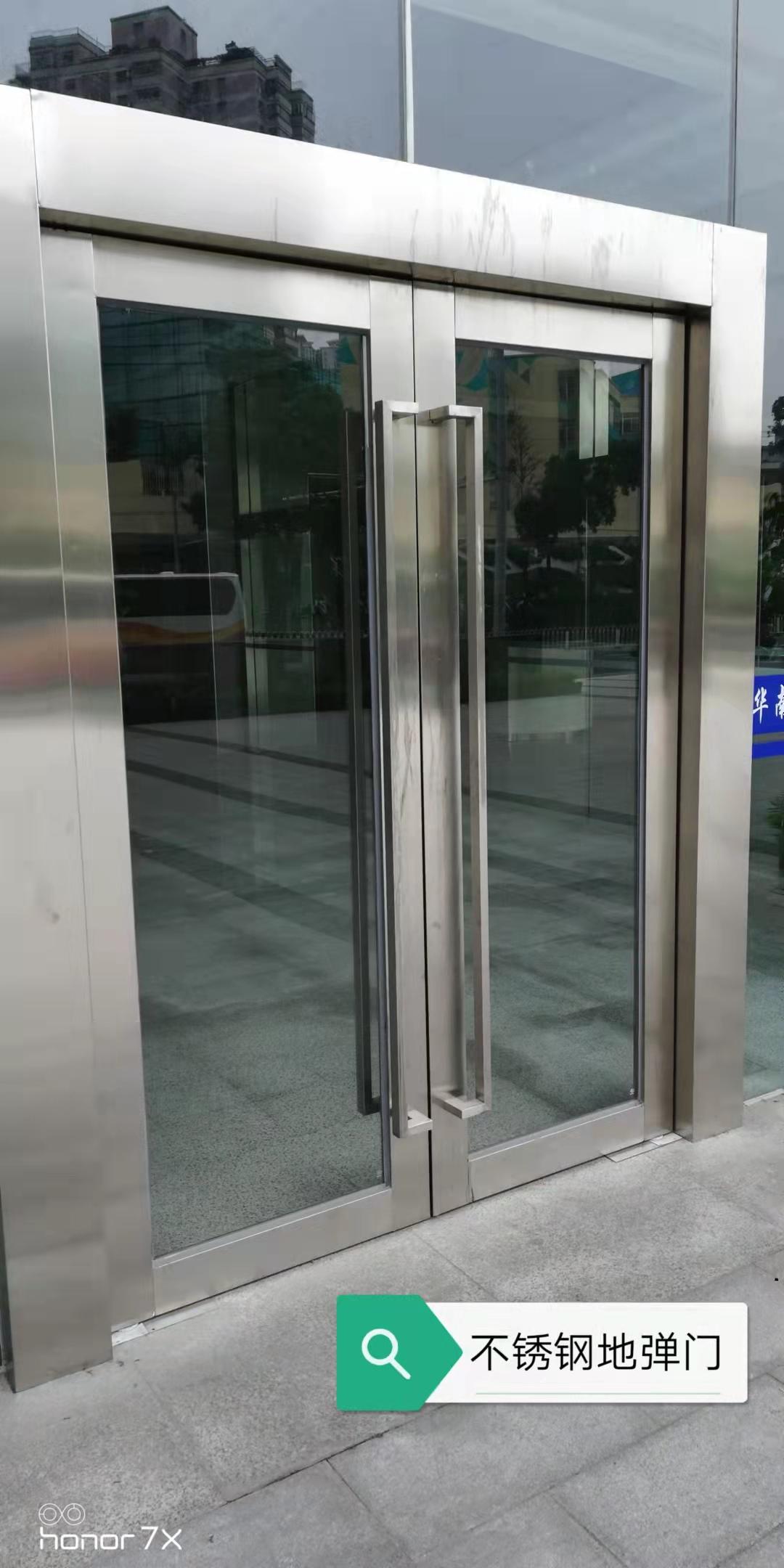 不锈钢框地弹门